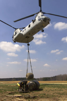 010405-M-1586C-004  CAMP LEJEUNE, N.C. -- Marines from HMM-365 (Rein.) deliver a 500-gallon water bladder to MSSG-26 so the unit can set up an expeditionary resupply station to support BLT 3/6. Photo by: Cpl. Thomas Michael Corcoran