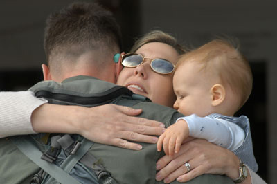 Pam, and son Ethan hug goodbye husband and father Maj. J.J., AV-8B pilot, who departed with Marine Attack Squadron 223 in support of the 26th Marine Expeditionary Unit (Special Operations Capable) March 5. Photo by: Pvt. Rocco DeFilippis